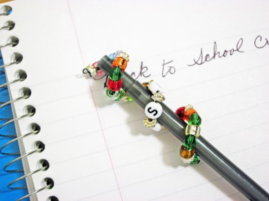 Decorate a pen with beads.