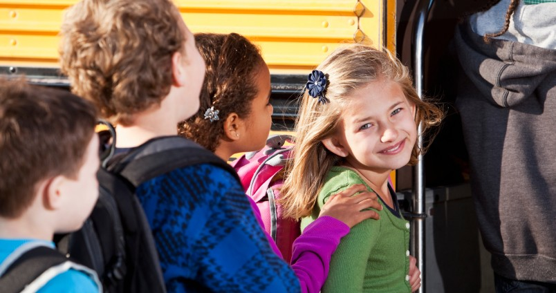 Children boarding the bus for back to school