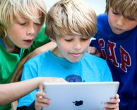 Children with an iPad
